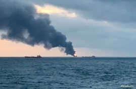 Smoke rises from a fire from two ships in the Kerch Strait near Crimea Jan. 21, 2019 in this still image taken from Reuters TV footage.