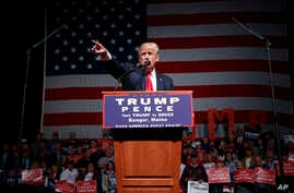 Republican presidential candidate Donald Trump speaks at a campaign rally in Bangor, Maine, Oct. 15, 2016. Trump has turned up the heat in his campaign by claining that media has conspired against him to get his Democratic rival Hillary Clinton elect...