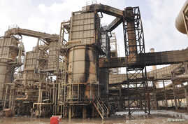 FILE - A view of a damaged production unit after a bomb attack by militants at Baiji oil refinery, 180 kilometers north of Baghdad, Iraq, Feb. 26, 2011.