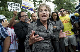 FILE - Representative Jan Schakowsky, a Democrat from Illinois, (C) joins immigration reform supporters as they block a street on Capitol Hill in Washington, August 2013.