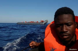 A migrant reacts after being rescued from a rubber dinghy by the Malta-based NGO Migrant Offshore Aid Station (MOAS) in the central Mediterranean in international waters some 15 nautical miles off the coast of Zawiya in Libya, April 14, 2017.