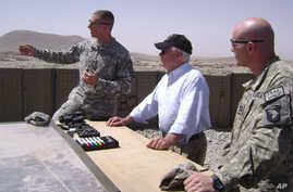 Secretary Gates receives a briefing from officers at Combat Outpost Senjaray, Afghanistan