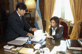 FILE - Argentina's President Cristina Fernandez talks to Legal and Technical Secretary Carlos Zannini at the presidential palace in Buenos Aires, May 29, 2008.