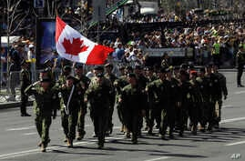 FILE  -Canada's soldiers march along main Khreshchatyk Street during a military parade to celebrate Independence Day in Kyiv, Ukraine, Aug. 24, 2018..