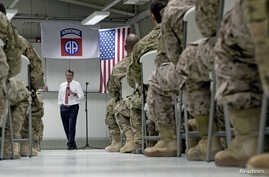 U.S. Defense Secretary Ash Carter talks to U.S. troops from the 82nd Airborne Division at the Baghdad International Airport in Baghdad, Iraq, July 23, 2015.