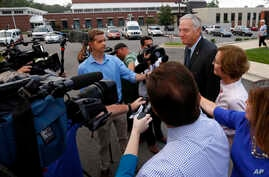 Senator Luther Strange talks with media after voting with his wife, Melissa, Aug. 15, 2017, in Homewood, Ala.