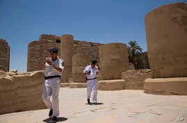 Egyptian policemen patrol the ruins of the Karnak Temple in Luxor, Egypt, June 11, 2015.