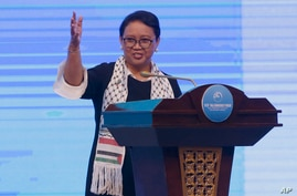 Wearing a Palestinian scarf, Indonesian Foreign Minister Retno Marsudi, gestures as she delivers her opening speech at Bali Democracy Forum held in Tangerang on the outskirts of Jakarta, Indonesia, Thursday, Dec. 7, 2017. Marsudi condemned the U.S. r