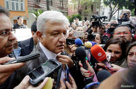Mexican President-elect Andres Manuel Lopez Obrador talks to journalist as he arrives to a meeting with his new cabinet in Mexico City, Mexico, July 7, 2018.