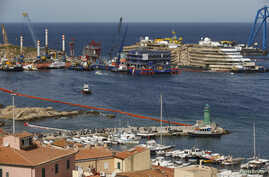 "The cruise liner Costa Concordia is seen at the end of the ""parbuckling"" operation outside Giglio harbor, Italy, Sept. 17, 2013."