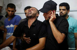 A relative of a Palestinian who was killed during a protest at the Israel-Gaza border fence reacts in Gaza City, Sept. 28, 2018.