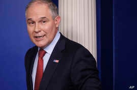 EPA Administrator Scott Pruitt, seen in this June 2, 2017 photo, looks back after speaking to the media during the daily briefing in the Brady Press Briefing Room of the White House in Washington. Records show Pruitt spent weekends in his home state