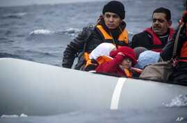 FILE - Migrants on a dinghy arrive from the Turkish coast at the Greek island of Lesbos, Jan. 29, 2016.