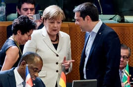 Greek Prime Minister Alexis Tsipras speaks with German Chancellor Angela Merkel during a meeting at the European Union-Community of Latin American and Caribbean States summit in Brussels, June 10, 2015.