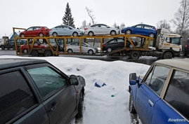 An autocart transports new cars on the road between Moscow and St.Petersburg, Feb. 6, 2013.