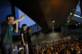 Joshua Wong, 17-year old student leader, address protesters during a rally in the occupied areas at Central district in Hong Kong, Oct. 9, 2014.
