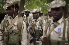 Chadian troops participate in the closing ceremony of operation Flintlock in an army base in N'djamena, Chad, Monday, March 9, 2015. The U.S. military and its Western partners conduct this training annually and set up plans long before Boko Haram beg