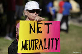 FILE - Lori Erlendsson attends a pro-net neutrality Internet activist rally in Los Angeles, California.