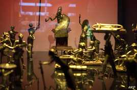 FILE - This photo shows the Ato ceremony of the Kingdom of Dahomey, circa 1934, on May 18, 2018, at the Quai Branly Museum-Jacques Chirac in Paris. Experts appointed by President Emmanuel Macron advised him on Nov. 23, 2018, to allow the return of th