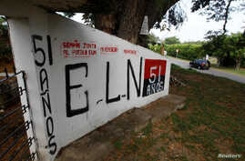 A graffiti, of rebel group Army Liberation National (ELN) is seen at the entrance of the cemetery of El Palo, Cauca, Colombia, Feb. 10, 2016.