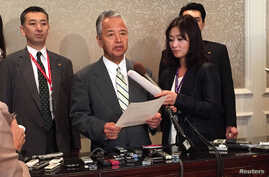 Japanese trade minister Akira Amari speaks to reporters during a break in the Trans-Pacific Partnership talks in Atlanta, Oct. 3, 2015.