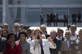 Brazil's President Dilma Rousseff speaks after leaving Planalto presidential palace in Brasilia, May 12, 2016.