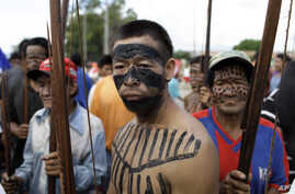 FILE - A group of Ache indigenous men block a highway in Asuncion, Paraguay, March 31, 2011, demanding the government return their ancestral lands, over 11,000 acres, near the Mbaracayu Forest Nature Reserve.