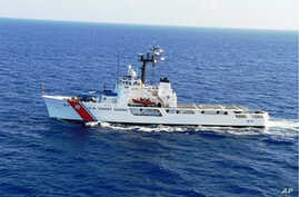FILE - This undated handout photo provided by the US Coast Guard shows US Coast Guard Cutter Vigilant. The U.S. Coast Guard has suspended the search for a group of Cuban migrants reported missing from a makeshift vessel that capsized off the Florida