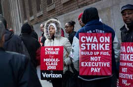 Verizon workers picket in front of a company facility in New York, April 13, 2016.