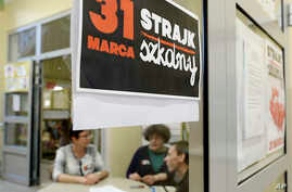 """A poster at  the door in a school  reads:  """"School Strike March 31"""" in Warsaw, Poland, on March 31, 2017."""