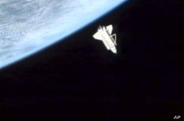 In a frame grab made from NASA TV, space shuttle Discovery leaves the International Space Station for the last time Monday, March 7, 2011.   Discovery is due back on Earth on Wednesday. It's being retired after touchdown and sent to the Smithsonian I