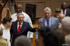 Cuba's President Raul Castro (C-L) and First Vice-President Miguel Diaz-Canel (C-R) arrive for a session of the National Assembly in Havana, Cuba, April 18, 2018. Diaz-Canel was named to succeed Castro Thursday.