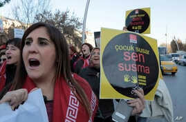A woman holds a placard as thousands of members of Turkey's main opposition Republican People's Party march to the parliament in Ankara, Turkey, Nov. 22, 2016.