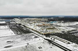 FILE - Snow covers the perimeter of the General Motors' Lordstown plant, in Lordstown, Ohio, Nov. 28, 2018.