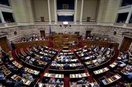Lawmakers attend a parliament meeting in Athens in the early morning hours of July 16, 2015.