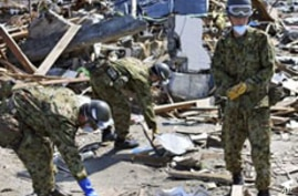 Japanese Troops Scour Coast for Missing Bodies