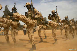 FILE - Chadian soldiers march during Flintlock 2014, a U.S.-led international training mission for African militaries, in Diffa, Niger, March 3, 2014.
