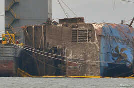 The sunken ferry Sewol is seen during its salvage operations on the sea off Jindo, South Korea, March 24, 2017.