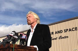 Billionaire Virgin Galactic founder Richard Branson salutes the bravery of test pilots, and vows to find out what caused the crash of his prototype space tourism rocket that killed one crew member and injured another during a news conference in Mojav