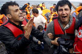A Greek Red Cross volunteer comforts a crying Syrian refugee moments after disembarking from a flooded raft at a beach on the Greek island of Lesbos after crossing a part of the Aegean Sea from the Turkish coast by an overcrowded raft Oct. 20, 2015.