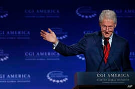 FILE - Former president Bill Clinton speaks at a gathering of the Clinton Global Initiative America, which is a part of The Clinton Foundation, in Denver, Colorado, June 10, 2015.