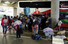 Venezuelan migrants arrive from the northern city of Tumbes in Peru, on the border with Ecuador, at the bus terminal in Lima, Aug. 22, 2018.