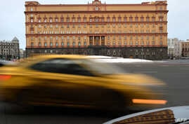 Cars drive past the headquarters of the FSB security service, the successor to the KGB in central Moscow on Dec. 30, 2016.