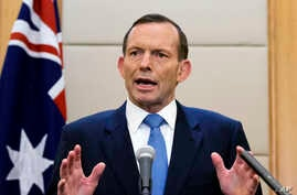 FILE - In this April 12, 2014, Australian Prime Minister Tony Abbott speaks during a press conference at a hotel in Beijing, China. Abbott said Monday, April 28 that the underwater hunt for the missing Malaysia Airlines jet will be expanded to includ