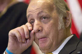 Former White House press secretary James Brady, who was left paralyzed in the Reagan assassination attempt, wipes his eye during a news conference marking the 30th anniversary of the shooting, on Capitol Hill in Washington, March 30, 2011.