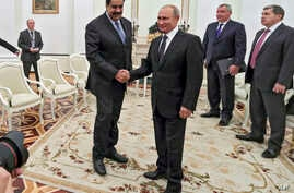 Russian President Vladimir Putin, center right, greets Venezuela's President Nicolas Maduro during their meeting at the Kremlin in Moscow, Russia, Oct. 4, 2017.