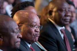 President Jacob Zuma (C) and deputy president Cyril Ramaphosa (R) attend the declaration announcement of the municipal elections in Pretoria, South Africa, Aug. 6, 2016. This is the worst-ever election showing for South Africa's ruling party,