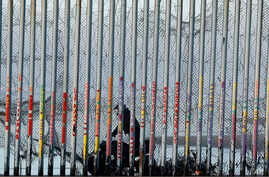 A U.S. Border Patrol agent rides a vehicle on the beach in San Diego, Jan. 9, 2019, seen through the border wall from Tijuana, Mexico.