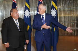 Nauru President Baron Divavesi Waqa, left, meets with Australian Prime Minister Malcolm Turnbull at the Commonwealth Parliamentary Offices in Sydney, April 6, 2017.