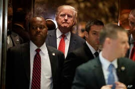 President-elect Donald Trump gets on an elevator after speaking with reporters at Trump Tower in New York,  Jan. 9, 2017.